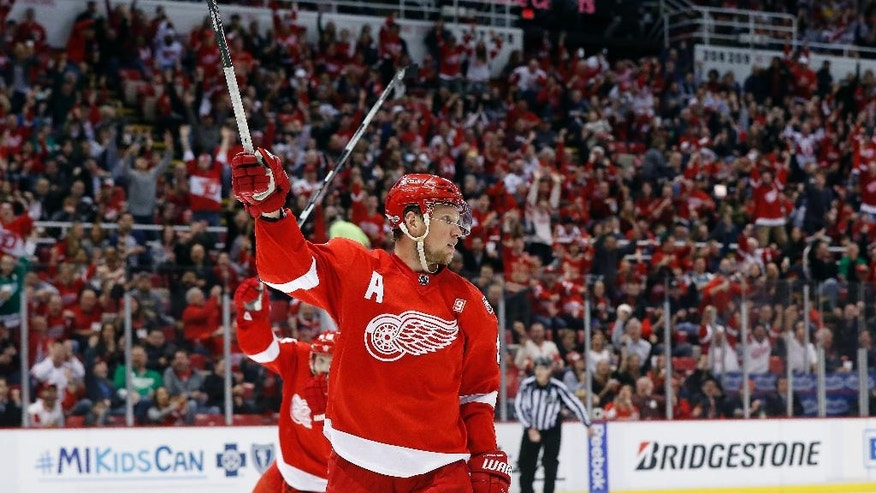 Detroit Red Wings' Justin Abdelkader (8) celebrates his goal against the Colorado Avalanche in the second period of an NHL hockey game Saturday, March 18, 2017, in Detroit. (AP Photo/Paul Sancya)