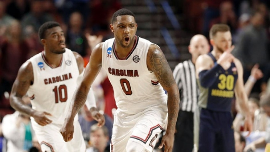 South Carolina's Sindarius Thornwell (0) reacts to making a basket against Marquette during the second half in a first-round game of the NCAA men's college basketball tournament in Greenville, S.C., Friday, March 17, 2017. (AP Photo/Chuck Burton)