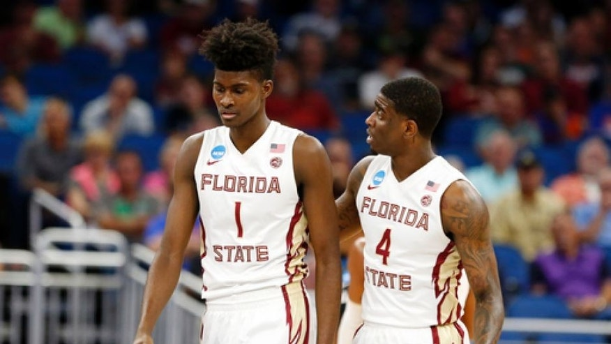 Florida State guard Dwayne Bacon (4) talks to forward Jonathan Isaac (1) during the first half of a second-round game against Xavier in the NCAA men's college basketball tournament Saturday, March 18, 2017 in Orlando, Fla. (AP Photo/Wilfredo Lee)