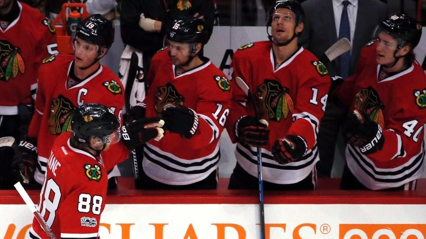 Chicago Blackhawks right Patrick Kane (88) celebrates with teammates after scoring his goal against the Colorado Avalanche during the first period of an NHL hockey game Sunday, March 19, 2017, in Chicago. (AP Photo/Nam Y. Huh)