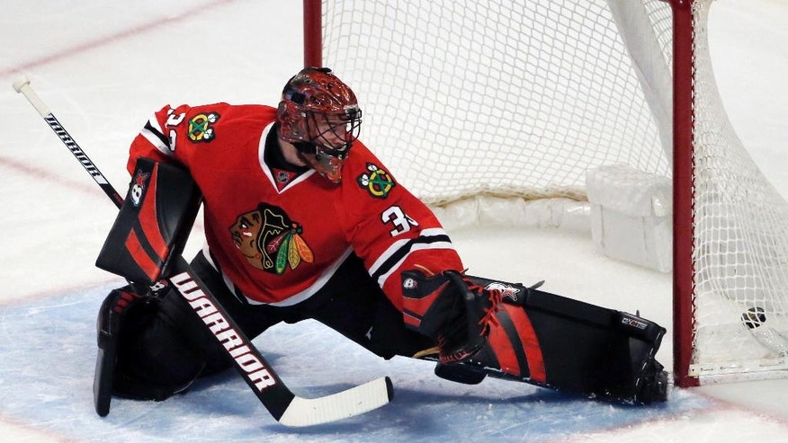 Chicago Blackhawks goalie Scott Darling can't stop a goal by Colorado Avalanche center Mikhail Grigorenko during the first period of an NHL hockey game Sunday, March 19, 2017, in Chicago. (AP Photo/Nam Y. Huh)