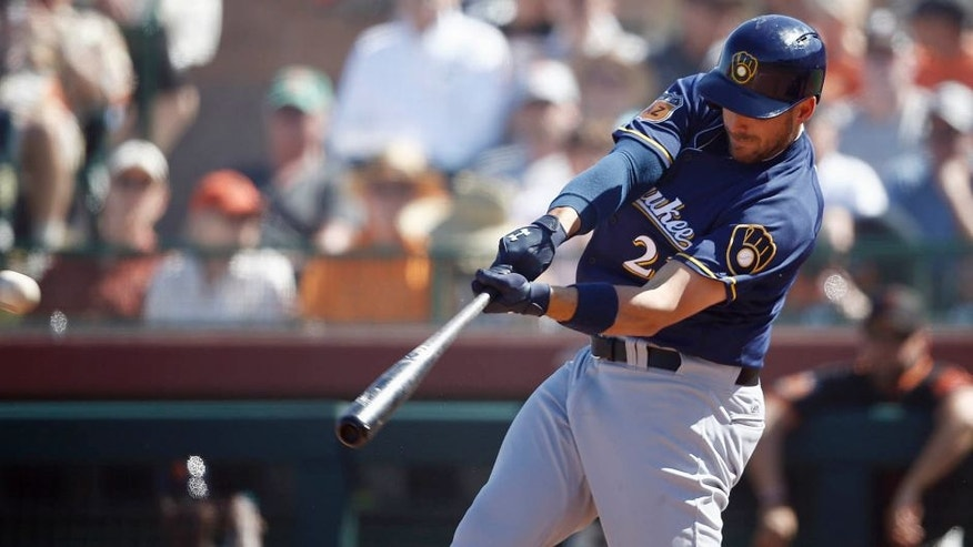 Milwaukee Brewers' Travis Shaw connects for a run-scoring double against the San Francisco Giants during the fifth inning of a spring training baseball game Sunday, March 19, 2017, in Scottsdale, Ariz. (AP Photo/Ross D. Franklin)