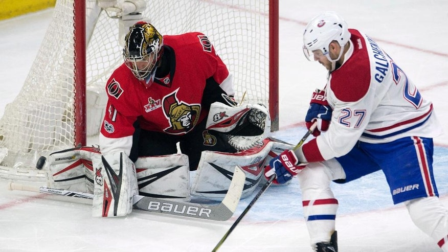Montreal Canadiens centre Alex Galchenyuk (27) puts the puck wide past Ottawa Senators goalie Craig Anderson (41) during second-period NHL hockey game action in Ottawa, Ontario, Saturday, March 18, 2017. (Adrian Wyld/The Canadian Press via AP)