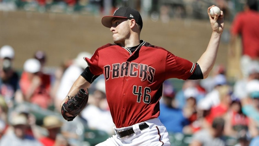 Arizona Diamondbacks' Patrick Corbin throws during the first inning of a spring training baseball game against the Texas Rangers, Tuesday, March 14, 2017, in Scottsdale, Ariz. (AP Photo/Darron Cummings)