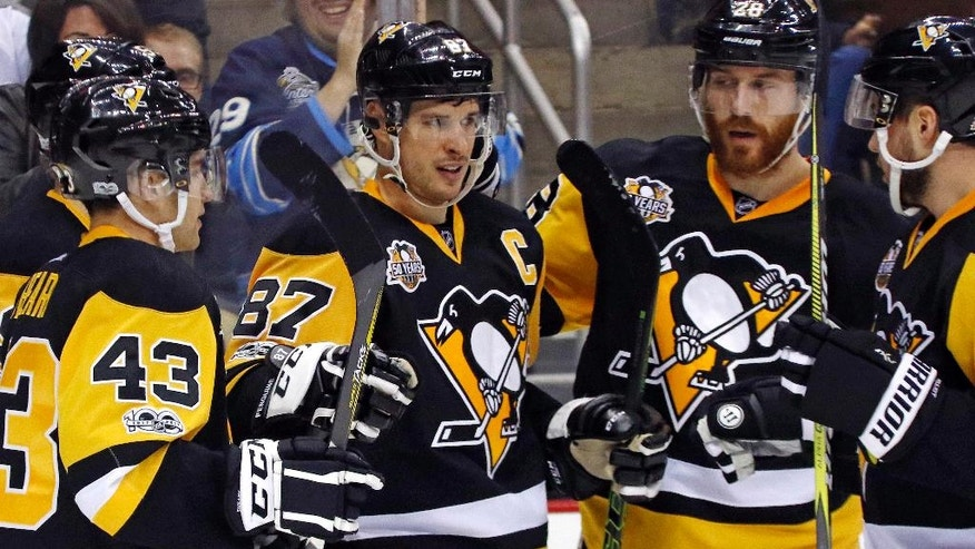 Pittsburgh Penguins' Sidney Crosby (87) celebrates his first goal of the second period during an NHL hockey game against the Florida Panthers in Pittsburgh, Sunday, March 19, 2017. (AP Photo/Gene J. Puskar)