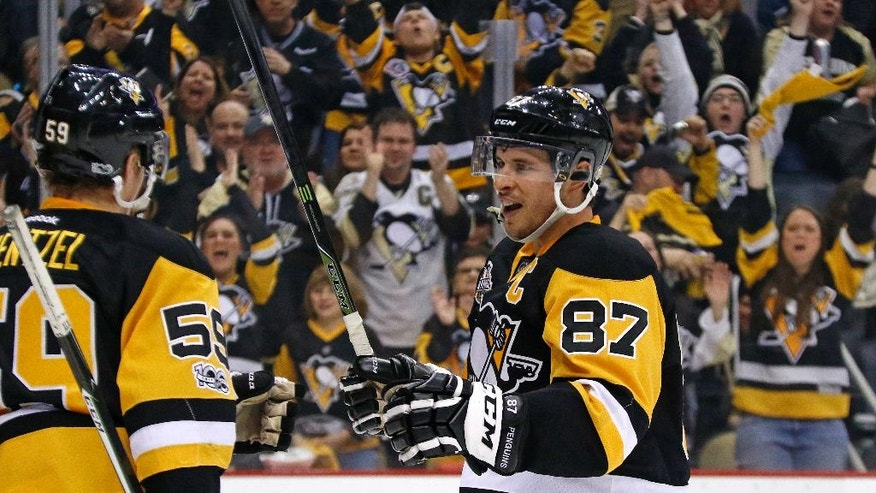 Pittsburgh Penguins' Sidney Crosby (87) celebrates his second goal of the second period during an NHL hockey game against the Florida Panthers in Pittsburgh, Sunday, March 19, 2017. (AP Photo/Gene J. Puskar)
