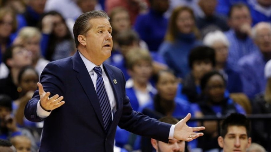Kentucky head coach John Calipari questions a call during the first half of a second-round game against Wichita State in the men's NCAA college basketball tournament in Indianapolis, Sunday, March 19, 2017. (AP Photo/Michael Conroy)