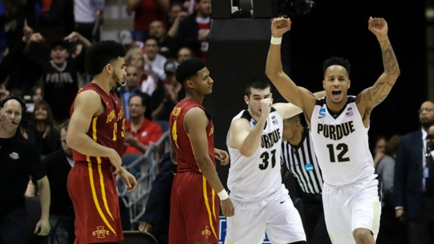 Purdue's Vince Edwards (12) and Dakota Mathias (31) celebrate after defeating Iowa State 80-76 in an NCAA college basketball tournament second-round game Saturday, March 18, 2017, in Milwaukee. (AP Photo/Morry Gash)