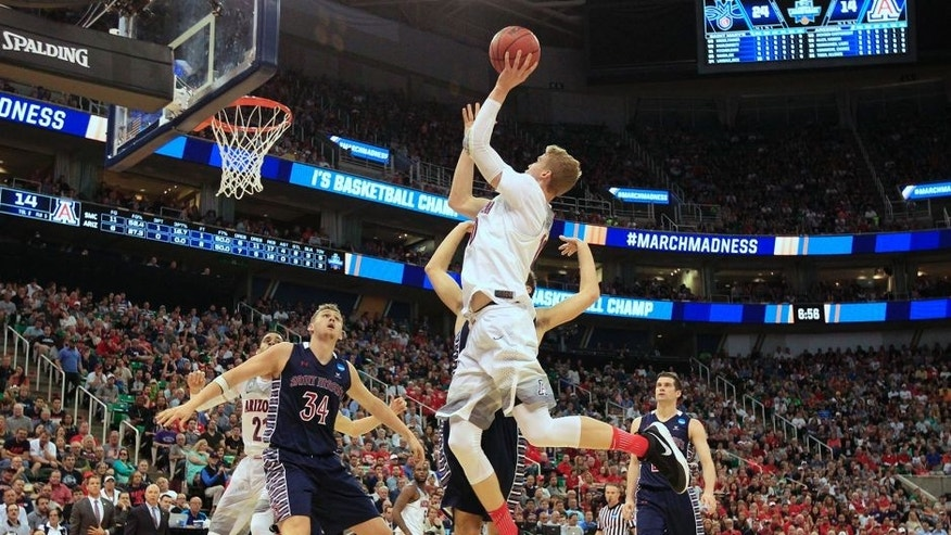 Arizona forward Lauri Markkanen (10) shoots the ball as Saint Mary's center Jock Landale (34) blocks out for the rebound during the first half of a second-round college basketball game in the men's NCAA Tournament Saturday, March 18, 2017, in Salt Lake City. (AP Photo/George Frey)