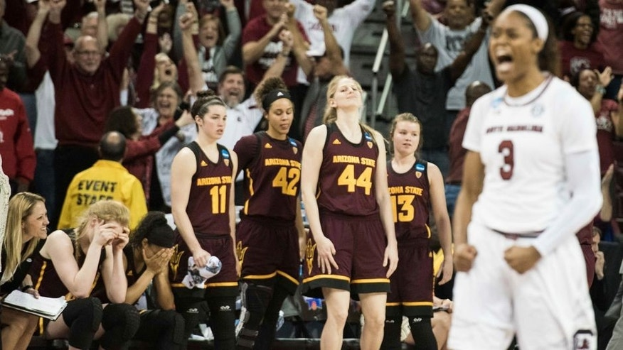 Arizona State players react from the bench as South Carolina guard Kaela Davis (3) celebrates at the conclusion of a second-round game in the NCAA women's college basketball tournament Sunday, March 19, 2017, in Columbia, S.C. South Carolina defeated Arizona State 71-68. (AP Photo/Sean Rayford)