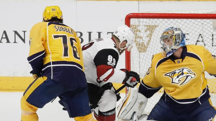 Nashville Predators defenseman P.K. Subban (76) and Arizona Coyotes left wing Jamie McGinn (88) look for the rebound after Nashville Predators goalie Pekka Rinne, of Finland, right, blocked a shot during the second period of an NHL hockey game Monday, March 20, 2017, in Nashville, Tenn. (AP Photo/Mark Humphrey)