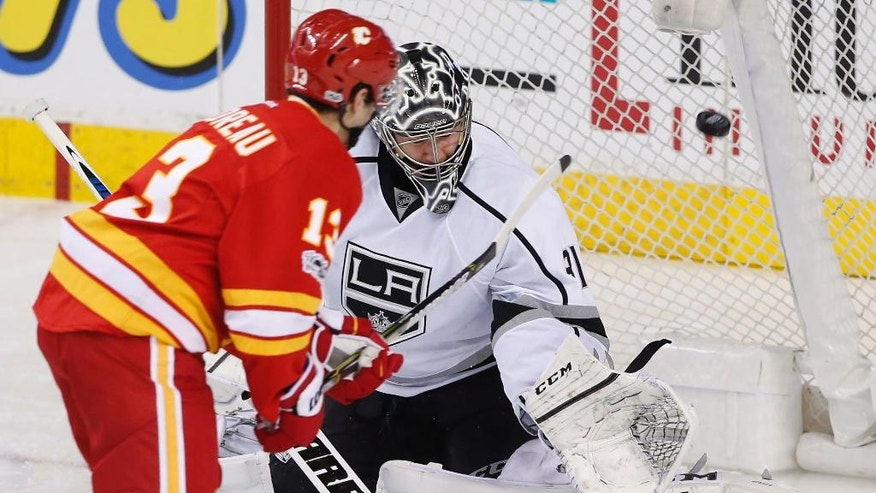 Los Angeles Kings goalie Ben Bishop, right, gives up a goal to Calgary Flames' Johnny Gaudreau during the second period of an NHL hockey game in Calgary, Alberta, Sunday, March 19, 2017.  (Larry MacDougal/The Canadian Press via AP)
