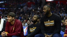 LOS ANGELES, CA - MARCH 18: (left to right) Kyle Korver #26, Kyrie Irving #2 and Lebron James #23 of the Cleveland Cavaliers sitting out the game against the Los Angeles Clippers on March 18, 2017 at STAPLES Center in Los Angeles, California. NOTE TO USER: User expressly acknowledges and agrees that, by downloading and or using this photograph, User is consenting to the terms and conditions of the Getty Images License Agreement. (Photo by Robert Laberge/Getty Images)