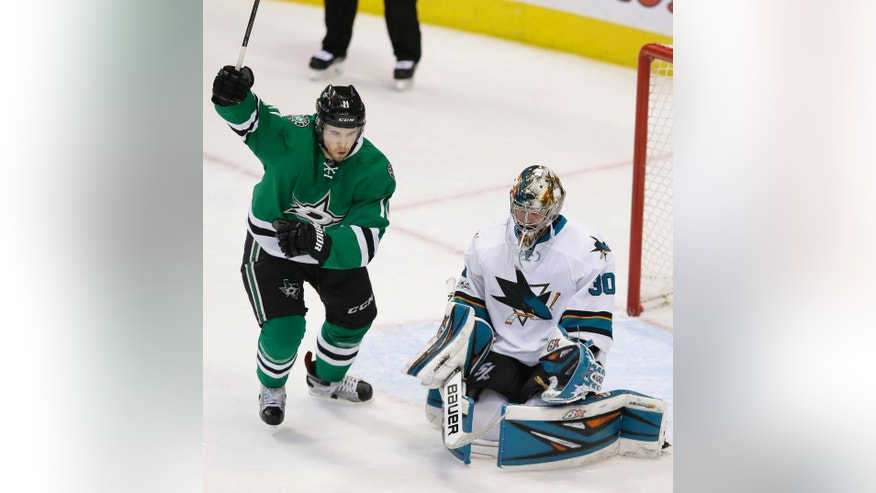 Dallas Stars left wing Curtis McKenzie (11) reacts after scoring a goal against San Jose Sharks goalie Aaron Dell (30) during the second period of an NHL hockey game in Dallas, Monday, March 20, 2017. (AP Photo/LM Otero)