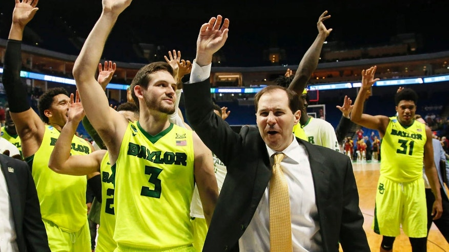 March 19, 2017: Baylor coach Scott Drew and his team wave to fans following a second-round game against Southern California in the NCAA men's college basketball tournament in Tulsa, Okla.