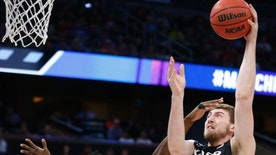Xavier forward Sean O'Mara (54) goes up for a shot over Florida State forward Jarquez Smith (23) as Dwayne Bacon (4) watches during the first half of a second-round game in the NCAA men's college basketball tournament, Saturday, March 18, 2017 in Orlando, Fla. (AP Photo/Wilfredo Lee)