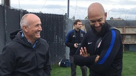 In this Friday, March 17, 2017, photo, U.S. goalkeeper Tim Howard, right, talks with San Jose Earthquakes coach Dominic Kinnear on a soccer practice field in San Jose, Calif. The team will play its first qualifier against Honduras in San Jose on Friday, March 24, 2017. (AP Photo/Janie McCauley)