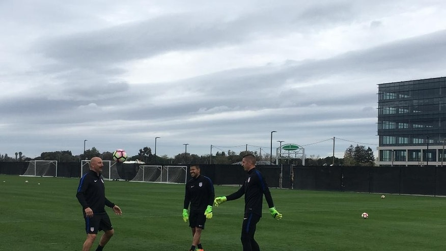 In this Friday, March 17, 2017, photo, U.S. goalkeepers coach Matt Reis, left, talks with goalkeepers Nick Rimando, center, and David Bingham on a soccer practice field in San Jose, Calif. The team will play its first qualifier against Honduras in San Jose on Friday, March 24, 2017. (AP Photo/Janie McCauley)