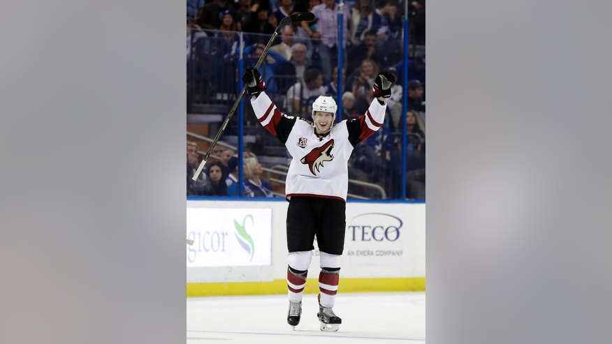 Arizona Coyotes defenseman Connor Murphy (5) celebrates after scoring against the Tampa Bay Lightning during the third period of an NHL hockey game Tuesday, March 21, 2017, in Tampa, Fla. The Coyotes won the game 5-3. (AP Photo/Chris O'Meara)