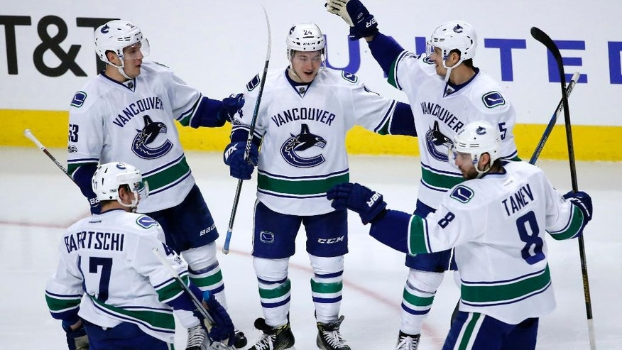 Vancouver Canucks' Reid Boucher, center, celebrates his goal with teammates during the second period of an NHL hockey game against the Chicago Blackhawks Tuesday, March 21, 2017, in Chicago. (AP Photo/Charles Rex Arbogast)