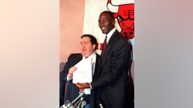 FILE - In this Sept. 21, 1988, file photo, Chicago Bulls' Michael Jordan, right, is all smiles after he signed a new contract with the NBA basketball team as general manager Jerry Krause looks on during a news conference in Chicago, Ill. Krause, the executive behind the Bulls' six NBA titles, has died, the team announced Tuesday, March 21, 2017. He was 77.   (AP Photo/Mark Elias, File)