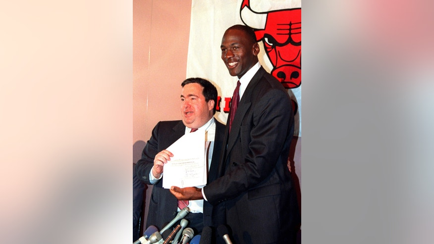 FILE - In this Sept. 21, 1988, file photo, Chicago Bulls' Michael Jordan, right, is all smiles after he signed a new contract with the NBA basketball team as general manager Jerry Krause looks on during a news conference in Chicago, Ill.