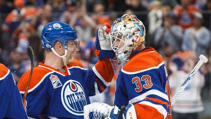 Edmonton Oilers' Matt Hendricks (23) congratulates goaltender Cam Talbot (33) after defeating the Los Angeles Kings during an NHL hockey game in Edmonton, Alberta, Monday, March 20, 2017. (Codie McLachlan/The Canadian Press via AP)