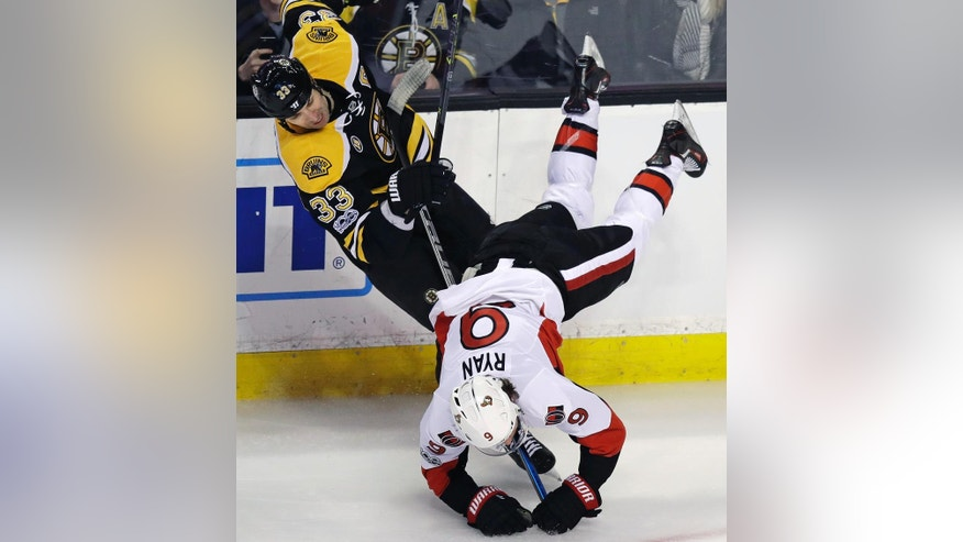 Ottawa Senators right wing Bobby Ryan (9) is upended as he collides with Boston Bruins defenseman Zdeno Chara (33) during the first period of an NHL hockey game in Boston, Tuesday, March 21, 2017. (AP Photo/Charles Krupa)