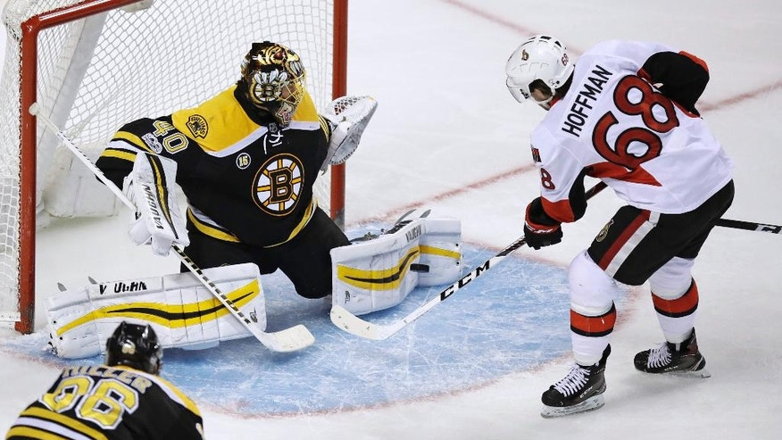 Boston Bruins goalie Tuukka Rask (40) makes a save on a shot by Ottawa Senators left wing Mike Hoffman (68) during the third period of an NHL hockey game in Boston, Tuesday, March 21, 2017. (AP Photo/Charles Krupa)