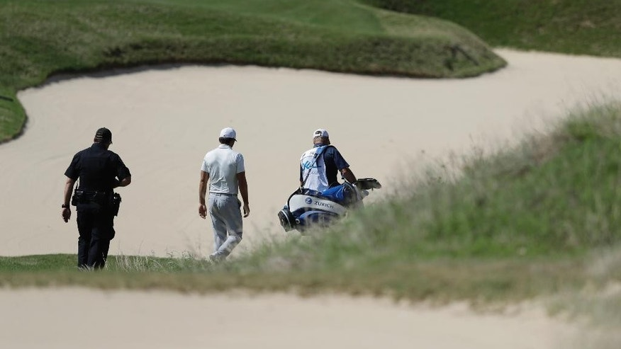 Defending champion Jason Day, center, of Australia, center, down the seventh hole after he conceded to Pat Perez after six holes of play during round-robin play at the Dell Technologies Match Play golf tournament at Austin County Club, Wednesday, March 22, 2017, in Austin, Texas. Day also withdrew from the tournament. (AP Photo/Eric Gay)
