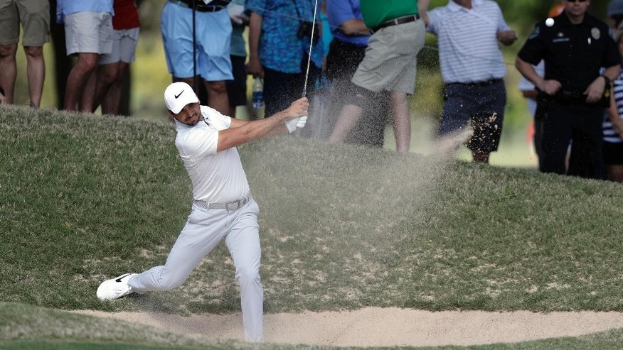 Defending champion Jason Day of Australia plays a shot from a bunker on the sixth hole during round-robin play at the Dell Technologies Match Play golf tournament at Austin County Club, Wednesday, March 22, 2017, in Austin, Texas. Day conceded to Pat Perez after the hole and withdrew from the tournament. (AP Photo/Eric Gay)