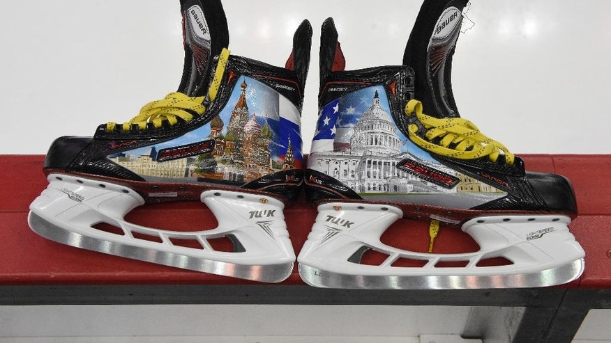Custom skates made for Washington Capitals left wing Alex Ovechkin, of Russia, and adorned with designs of the U.S. Capitol, right, and Moscow's St. Basil's Cathedral, left, are seen before an NHL hockey game between the Capitals and the Columbus Blue Jackets, Thursday, March 23, 2017, in Washington. (AP Photo/Nick Wass)