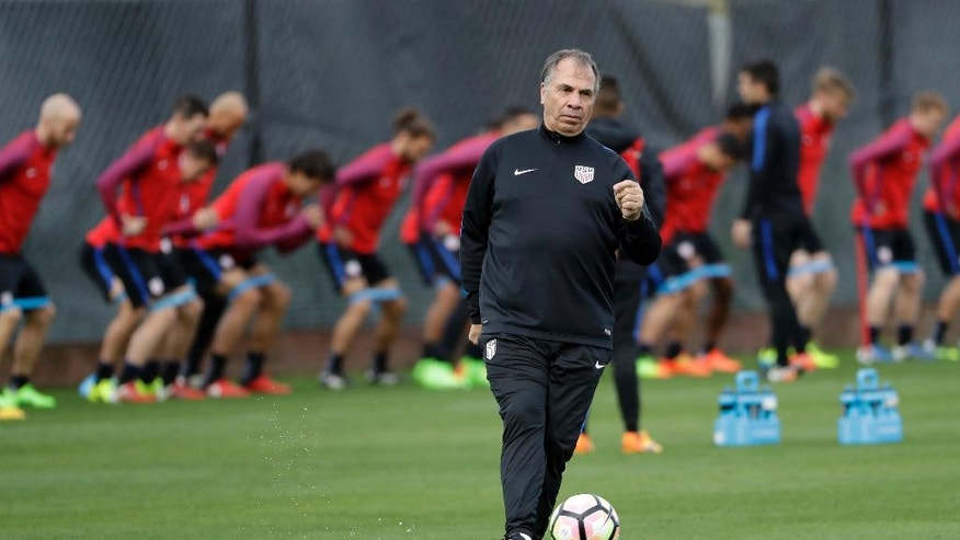 United States head coach Bruce Arena kicks a ball during a training session in preparation for a World Cup qualifying soccer match Wednesday, March 22, 2017, in San Jose, Calif. The U.S. face Honduras on Friday. (AP Photo/Marcio Jose Sanchez)