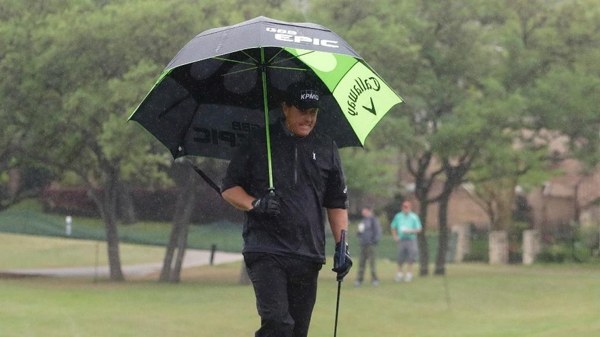 Phil Mickelson walks off the fifth green during round-robin play at the Dell Technologies Match Play golf tournament at Austin County Club, Friday, March 24, 2017, in Austin, Texas. (AP Photo/Eric Gay)
