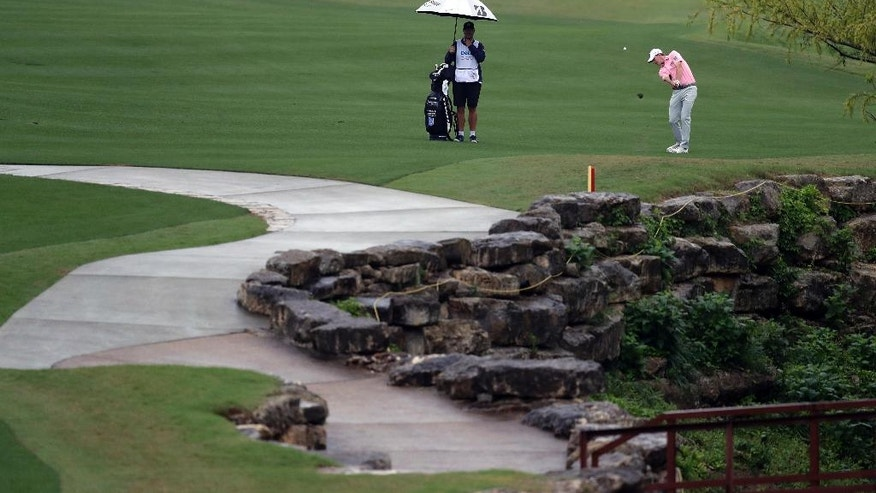 Brandt Snedeker, right, hits on the third hole during round-robin play at the Dell Technologies Match Play golf tournament at Austin County Club, Friday, March 24, 2017, in Austin, Texas. (AP Photo/Eric Gay)