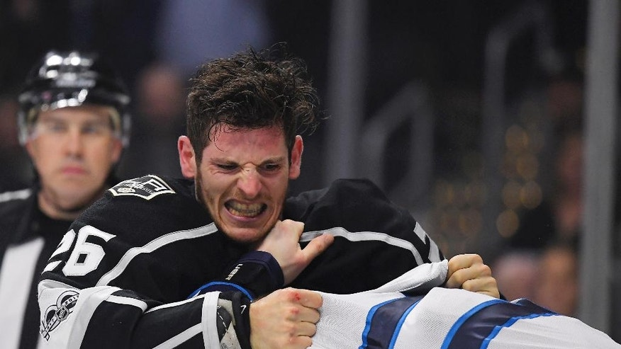 Los Angeles Kings center Nic Dowd, left, fights, with Winnipeg Jets center Adam Lowry during the first period of an NHL hockey game, Thursday, March 23, 2017, in Los Angeles. (AP Photo/Mark J. Terrill)