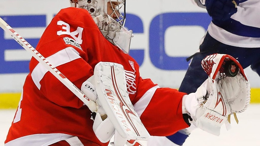 Detroit Red Wings goalie Petr Mrazek (34) stops a Tampa Bay Lightning shot in the third period of an NHL hockey game Friday, March 24, 2017, in Detroit. (AP Photo/Paul Sancya)