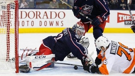 Columbus Blue Jackets' Sergei Bobrovsky, left, of Russia, tries to cover the puck as teammate Seth Jones, center, and Philadelphia Flyers' Chris VandeVelde look for the rebound during the first period of an NHL hockey game, Saturday, March 25, 2017, in Columbus, Ohio. (AP Photo/Jay LaPrete)