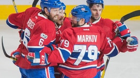 Montreal Canadiens' Andrei Markov (79) celebrates with teammates Shea Weber (6), Andrew Shaw and Alexander Radulov (79) after scoring against the Ottawa Senators during the second period of an NHL hockey game Saturday, March 25, 2017, in Montreal. (Graham Hughes/The Canadian Press via AP)