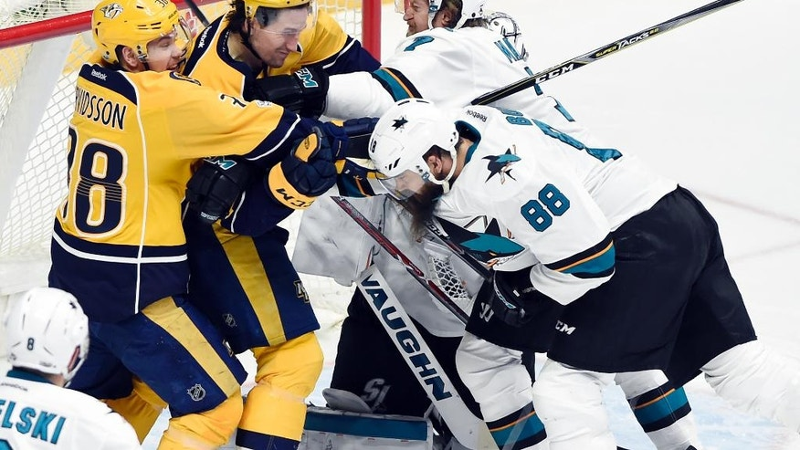 Nashville Predators' Viktor Arvidsson (38), and Filip Forsberg (9), both from Sweden, scuffle with San Jose Sharks' Brent Burns (88) and Paul Martin (7) in front of the net during second period of an NHL hockey game Saturday, March 25, 2017, in Nashville, Tenn. (AP Photo/Mark Zaleski)