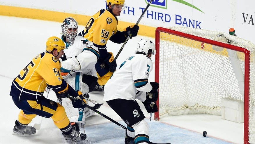 Nashville Predators left wing Cody McLeod (55) skates in as he scores a goal against San Jose Sharks goalie Martin Jones (31) and defenseman Paul Martin (7) during the first period of an NHL hockey game Saturday, March 25, 2017, in Nashville, Tenn. (AP Photo/Mark Zaleski)