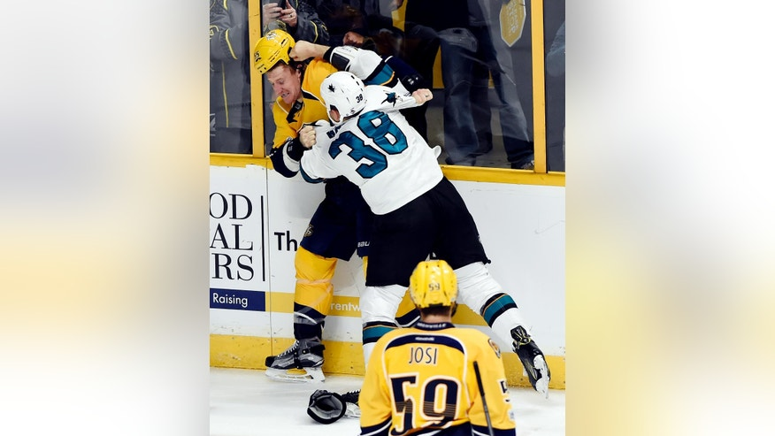 Nashville Predators left wing Cody McLeod, left, fights with San Jose Sharks center Micheal Haley, right, during the first period of an NHL hockey game Saturday, March 25, 2017, in Nashville, Tenn. (AP Photo/Mark Zaleski)