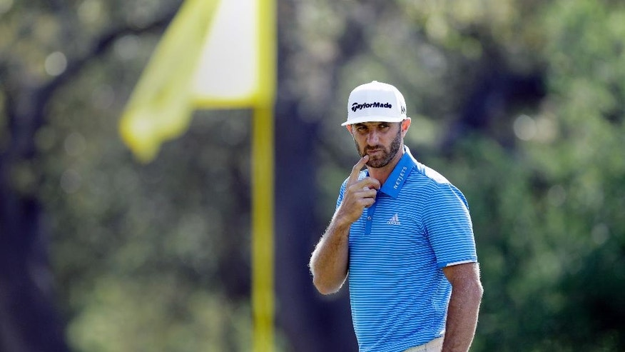 Dustin Johnson looks at his line on the sixth green during semifinal play at the Dell Technologies Match Play golf tournament at Austin County Club, Sunday, March 26, 2017, in Austin, Texas. (AP Photo/Eric Gay)