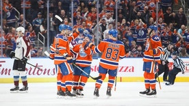 The Edmonton Oilers celebrate a goal during first-period NHL hockey game action against the Colorado Avalanche in Edmonton, Alberta, Saturday, March 25, 2017. (Codie McLachlan/The Canadian Press via AP)