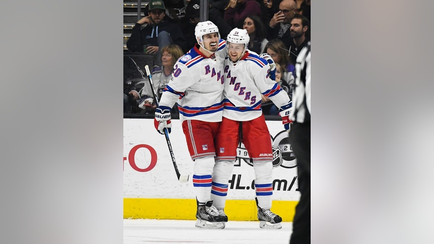 New York Rangers center Derek Stepan, right, celebrates his goal with left wing Chris Kreider during the second period of an NHL hockey game against the Los Angeles Kings, Saturday, March 25, 2017, in Los Angeles. (AP Photo/Mark J. Terrill)
