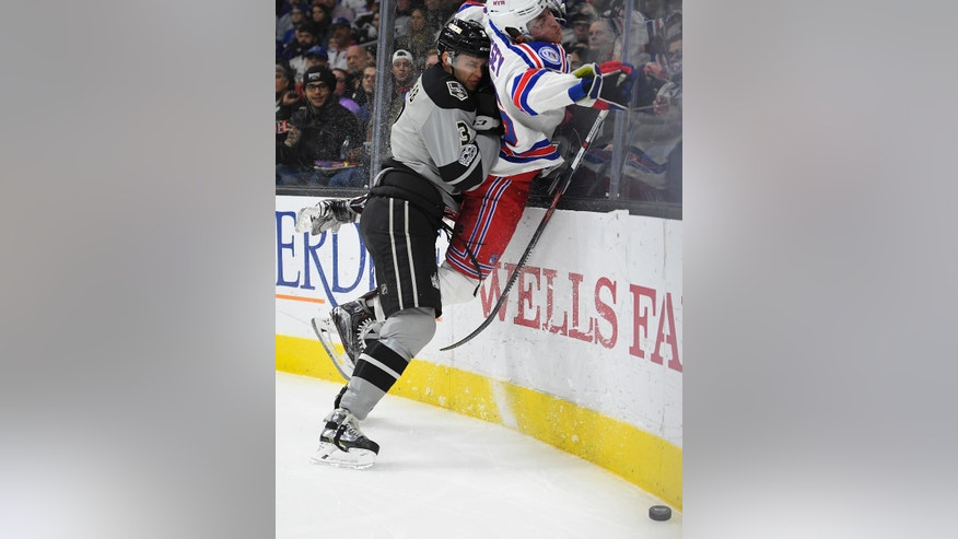 Los Angeles Kings defenseman Brayden McNabb, left, puts New York Rangers left wing Jimmy Vesey into the boards during the first period of an NHL hockey game, Saturday, March 25, 2017, in Los Angeles. (AP Photo/Mark J. Terrill)