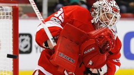 Detroit Red Wings goalie Jimmy Howard deflects a Minnesota Wild shot in the first period of an NHL hockey game Sunday, March 26, 2017, in Detroit. (AP Photo/Paul Sancya)