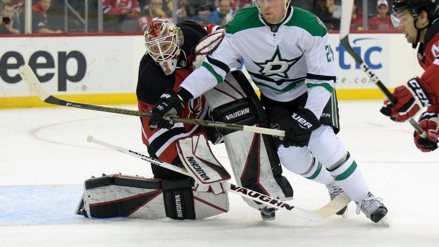 Dallas Stars right wing Brett Ritchie, right, runs into New Jersey Devils goalie Keith Kinkaid (1) during the first period of an NHL hockey game Sunday, March 26, 2017, in Newark, N.J. (AP Photo/Bill Kostroun)
