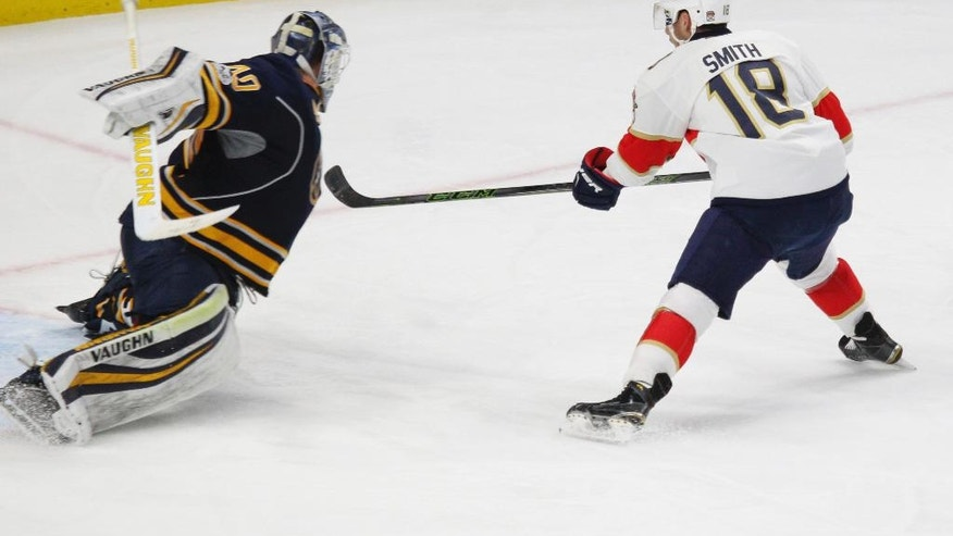 Buffalo Sabres goalie Robin Lehner (40) stops Florida Panthers forward Reilly Smith (18) on a penalty shot during the third period of an NHL hockey game, Monday, March 27, 2017, in Buffalo, N.Y. (AP Photo/Jeffrey T. Barnes)