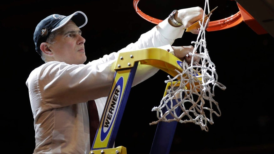 South Carolina head coach Frank Martin cuts down the net after beating Florida 77-70 in the East Regional championship game of the NCAA men's college basketball tournament, Sunday, March 26, 2017, in New York.